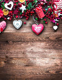 Valentine`s Day Background with love themed elements like cotton and paper hearts. Flowers, berries, oranges and other decorations. Wooden old parquet on the Royalty Free Stock Photography