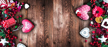 Valentine`s Day Background with love themed elements. Like cotton and paper hearts, flowers, berries, oranges and other decorations. Wooden old parquet on the Stock Image