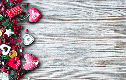 Valentine`s Day Background with love themed elements like cotton and paper hearts. Flowers, berries, oranges and other decorations. Wooden old parquet on the Stock Images