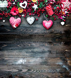 Valentine`s Day Background with love themed elements like cotton and paper hearts. Flowers, berries, oranges and other decorations. Wooden old parquet on the Stock Photography