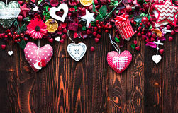Valentine`s Day Background with love themed elements like cotton and paper hearts. Flowers, berries, oranges and other decorations. Wooden old parquet on the Royalty Free Stock Photos
