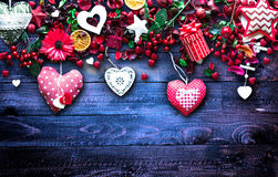Valentine`s Day Background with love themed elements like cotton and paper hearts. Flowers, berries, oranges and other decorations. Wooden old parquet on the Stock Photo