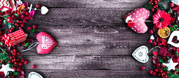Valentine`s Day Background with love themed elements like cotton and paper hearts. Flowers, berries, oranges and other decorations. Wooden old parquet on the Royalty Free Stock Photo