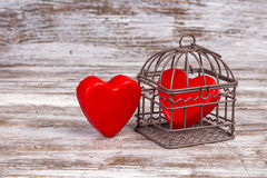Valentine's day background with one heart in cage Royalty Free Stock Photo