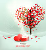 Valentine`s day background with an open red gift box. Stock Photos