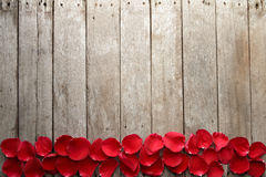 Valentine' s day background with petals of rose on wooden. Stock Photo