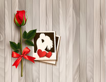 Valentine`s day background with photos, hearts, and a rose. Royalty Free Stock Photo