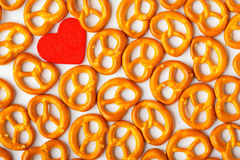 Valentine's day background pretzels pattern and red heart. Stock Photography