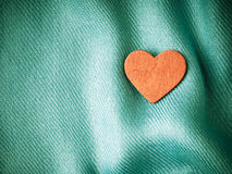 Valentine's day background. Red heart on blue folds cloth Royalty Free Stock Images