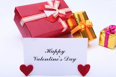 Valentine`s day background with red heart, gift box and greeting card. Stock Photography