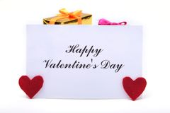 Valentine`s day background with red heart, gift box and greeting card. Stock Photo