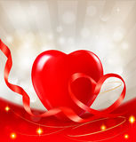 Valentine`s day background. Red heart with a ribbo Stock Image