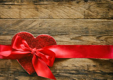 Valentine`s day background, red heart with silk ribbon Stock Image