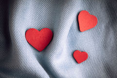 Valentine's day background. Red hearts on gray folds cloth Royalty Free Stock Photography