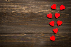 Valentine`s day background. Red hearts on the wooden desk. Valentine`s day background. Red hearts on the wooden texture desk royalty free stock photos