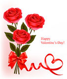 Valentine`s day background. Red roses with gift re Stock Photos