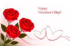 Valentine`s day background. Red roses with gift red bow. Royalty Free Stock Photo