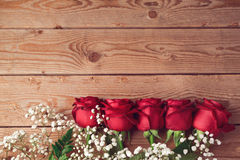Valentine's day background with red roses on wooden table. View from above Royalty Free Stock Photography