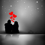 Valentine's Day background with silhouette of couples showing lo. Ve in night background. EPS 10 Stock Images