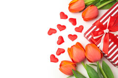 Valentine's day background with tulip flowers and gift box on white Royalty Free Stock Photo