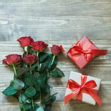 Valentine`s day background with two love gifts and red roses. View from above. Copy space. Flat lay. Mother day. Valentine`s day background with two love gifts Stock Photography