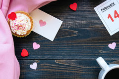 Valentine`s Day background. Valentine`s day card, cup of coffee and cupcake with copy space on the dark background Stock Photo