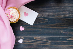 Valentine`s Day background. Valentine`s day card and cupcake with copy space on the wooden dark background Stock Photography
