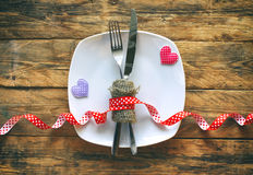 Valentine`s day background, white plate, fork, knife, two cloth Royalty Free Stock Image