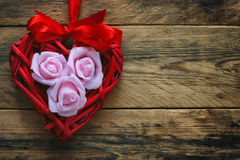 Valentine`s day background, wicker red heart Royalty Free Stock Image