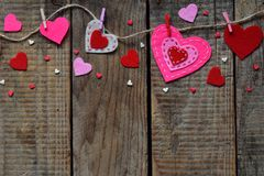 Valentine`s Day Background With Handmade Felt Hearts, Clothespins. Valentine Gift Making, Diy Hobby. Romantic, Love Concept. Happ Stock Photo