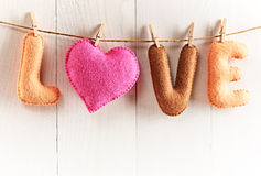 Love, Valentines Day. Word, heart on wood.Vintage. Love, Valentines Day. Word Love, Heart Handmade, hanging on rope. Vintage romantic style, white wooden Stock Photography
