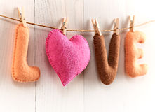 Love, Valentines Day. Word, heart on wood.Vintage. Love, Valentines Day. Word Love, Heart Handmade, hanging on rope. Vintage romantic style, white wooden Stock Image
