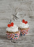 Valentine's day banana cupcakes with cream and red hearts Royalty Free Stock Image