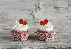 Valentine's day banana cupcakes with cream and red hearts Stock Image