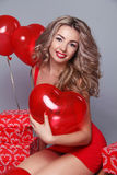 Valentine's Day. Beautiful happy woman with red heart balloons o Stock Photography