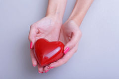 Valentine`s Day. Beautiful young woman with heart in her hands. Royalty Free Stock Photo
