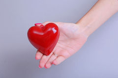 Valentine`s Day. Beautiful young woman with heart in her hands. Stock Photography