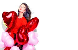Valentine`s Day. Beauty girl with colorful air balloons having fun Stock Images