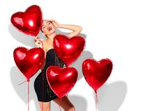 Valentine`s Day. Beauty girl with colorful air balloons having fun Stock Photography