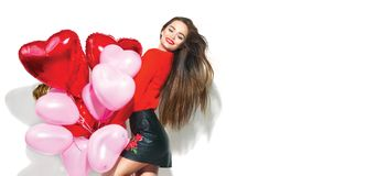 Valentine`s Day. Beauty girl with colorful air balloons having fun Stock Image