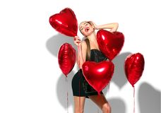 Valentine`s Day. Beauty girl with colorful air balloons having fun, isolated on white Royalty Free Stock Photos