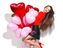 Valentine`s Day. Beauty girl with colorful air balloons having fun Royalty Free Stock Images