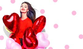 Valentine`s Day. Beauty girl with colorful air balloons having fun royalty free stock photography
