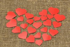 Valentine`s day. A big red heart from small hearts lies on a brown bag. Horizontal photography stock photos