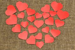 Valentine`s day. A big red heart from small hearts lies on a brown bag. Horizontal photography stock photo