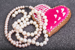 Valentine`s Day, birthday, Women`s Day gingerbread, pearls, gift Royalty Free Stock Image
