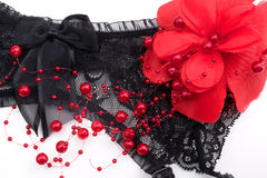 Valentine's Day black garter belt and red flower Royalty Free Stock Photos