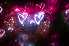 Valentine`s Day bokeh hearts in pink and purple Stock Image