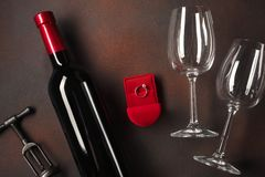 Valentine`s Day with a bottle of wine and a glass and an engagement ring. Top view with copy space.  stock photography