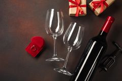 Valentine`s Day with a bottle of wine and a glass and an engagement ring. Top view with copy space.  stock photos